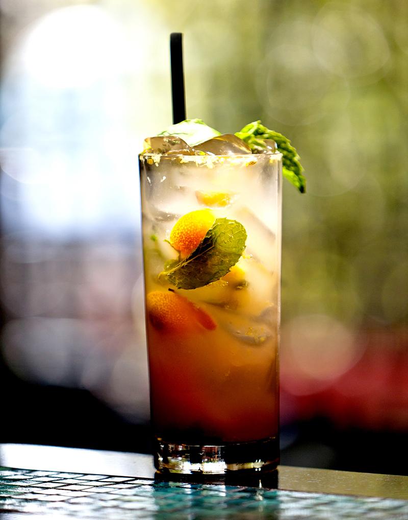 Starfish Cooler (cocktail) - Mandarin Vodka, muddled mandarin orange, fresh mint, splash of soda, Pama liqueur float