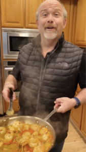 Bob cooking for his wife