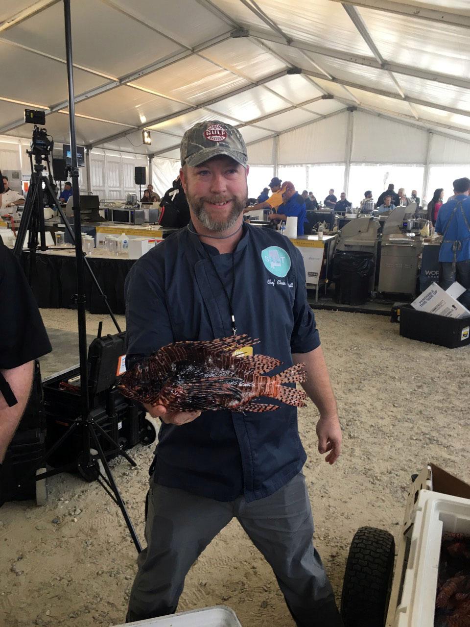 Chris holding a large Lion Fish