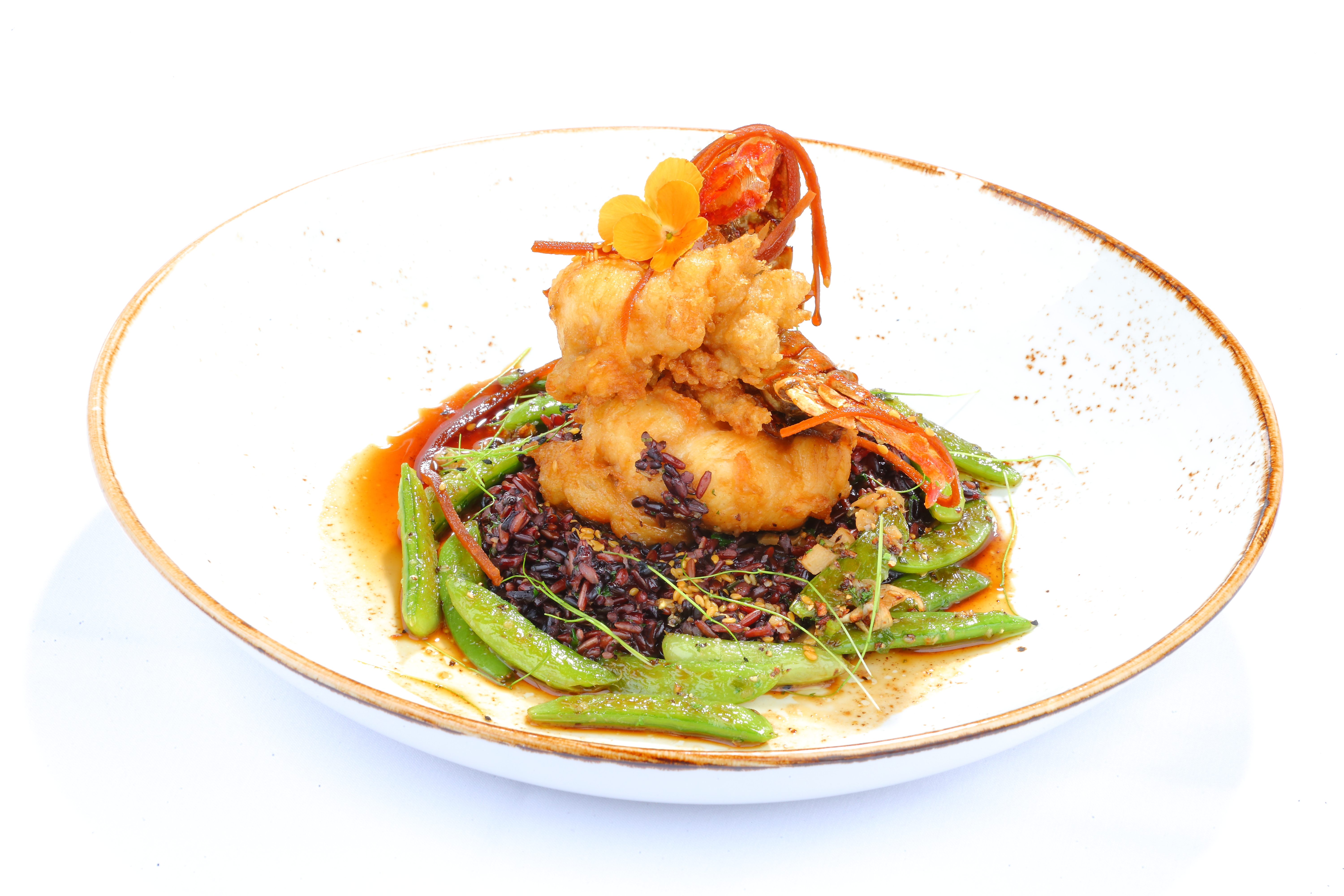 Crusted Dish Topped with a Crawfish with Snap Peas