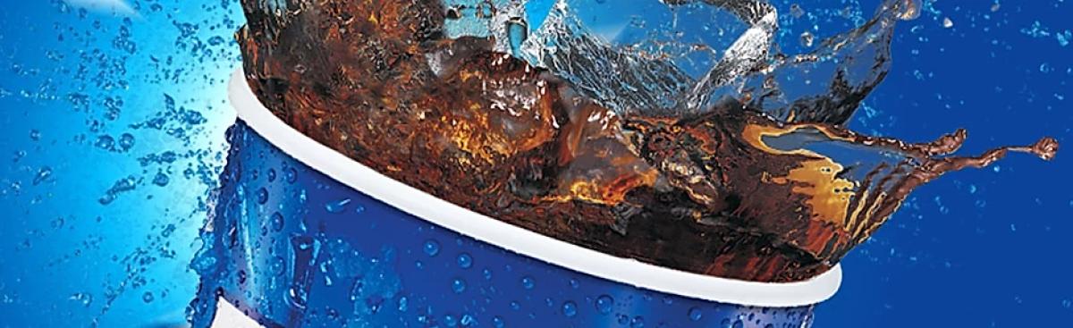 Close up of splashing cola drink