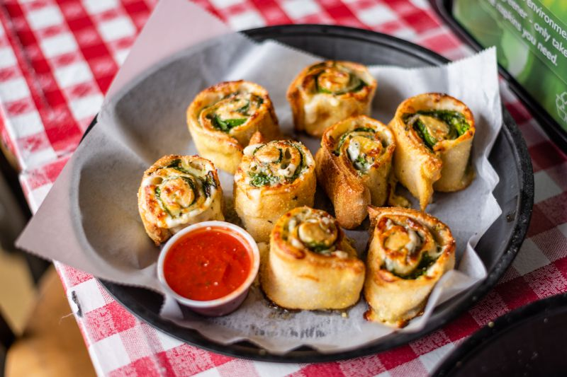 Pizza pinwheels with fresh spinach image
