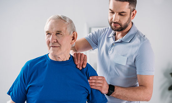 older man receiving physical therapy