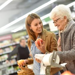 Caregiver helping a client grocery shop