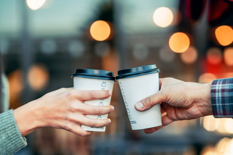 Two Hands holding Coffee Cups