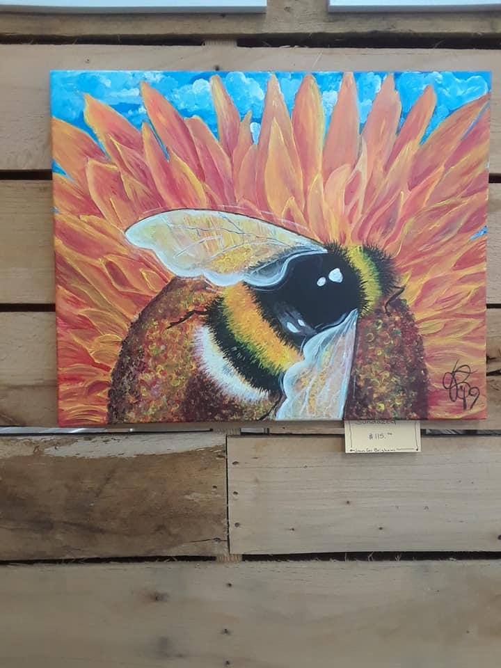 Local art hung at Apple Market