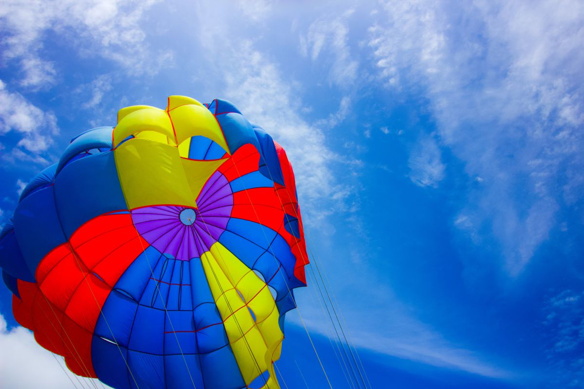 Top of colorful hot air balloon against blue sky