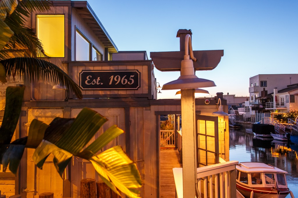 outside view of restaurant with deck signs on waterfront