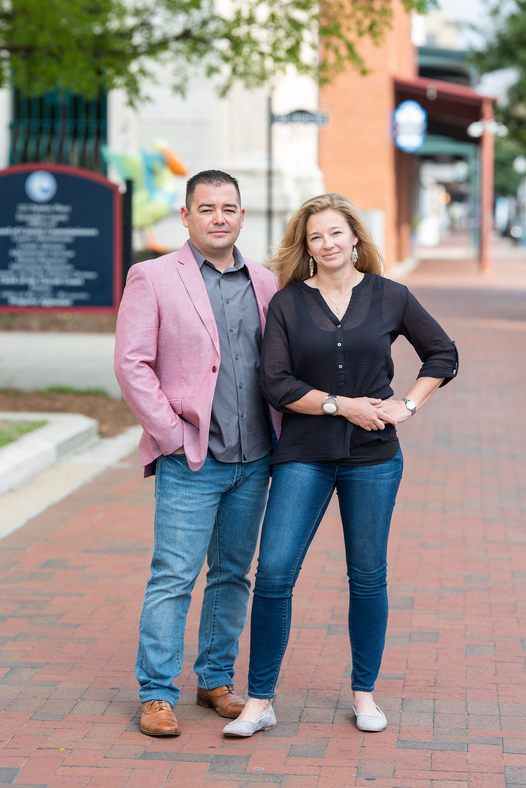 Kristen and Justin Deese; owners of Business Spouse posing in Downtown Pensacola