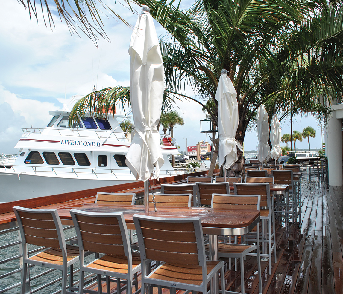 exterior picture of cumaru bar with the lively one charter boat in the background