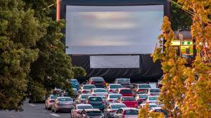 Cars parked in a drive-in movie lot