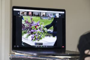 Image of a video funeral on a monitor