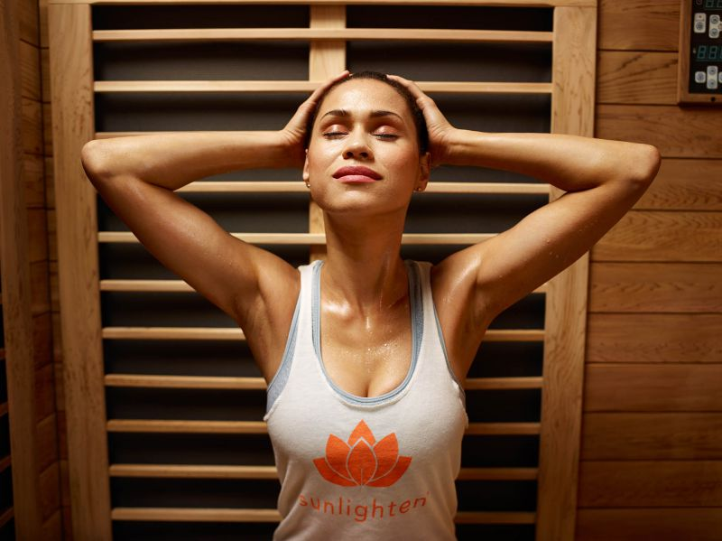Lady in Sunlighten tank using the Infrared Sauna